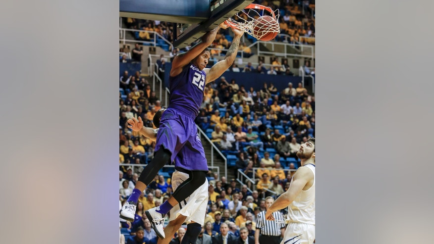 Kansas State's Rodney McGruder (22) dunks over West Virginia's Deniz Kilicli, right, during the first half of an NCAA college basketball game at WVU Coliseum in Morgantown, W.Va., on Saturday, Jan. 12, 2013. (AP Photo/David Smith)