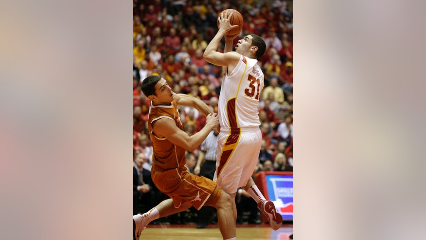 Iowa State forward Georges Niang, right, shoots over Texas forward Ioannis Papapetrou during the first half of an NCAA college basketball game, Saturday, Jan. 12, 2013, in Ames, Iowa. (AP Photo/Charlie Neibergall)