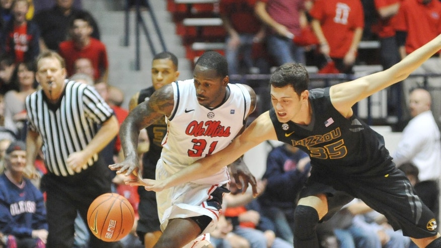 Mississippi's Murphy Holloway (31) is fouled by Missouri's Stefan Jankovic (35)  during an NCAA college basketball game in Oxford, Miss.  Saturday, Jan. 12, 2013. (AP Photo/Oxford Eagle, Bruce Newman)