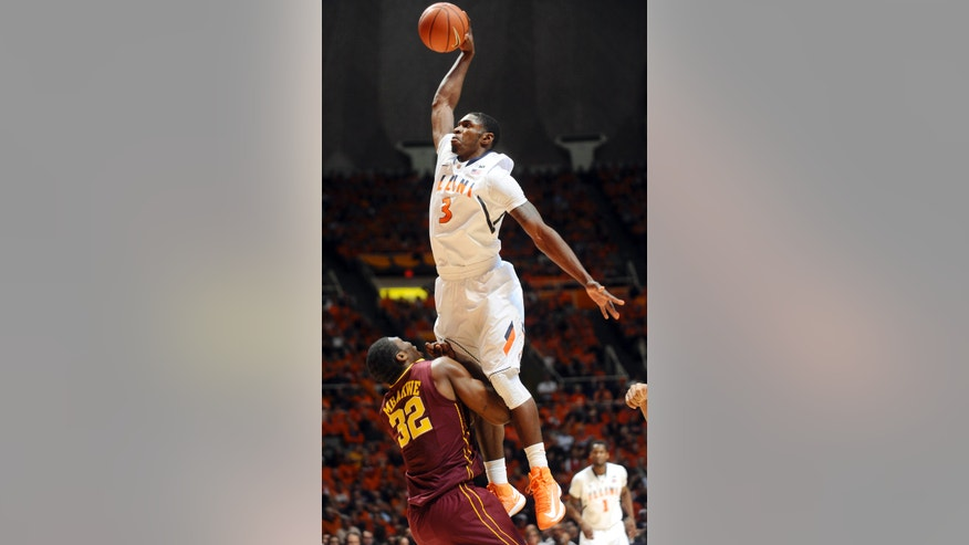 Illinois guard Brandon Paul (3) elevates over Minnesota forward Trevor Mbakwe (32) during their NCAA college basketball game, Wednesday, Jan. 9, 2013, in Champaign, Ill. (AP Photo/The News-Gazette, Darrell Hoemann)  MANDATORY CREDIT