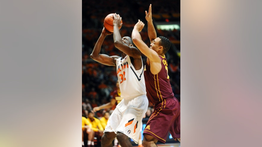 Illinois' Nnanna Egwu (32) shoots as Minnesota forward Rodney Williams (33) defends during their NCAA college basketball game, Wednesday, Jan. 9, 2013, in Champaign, Ill. (AP Photo/The News-Gazette, Darrell Hoemann)  MANDATORY CREDIT