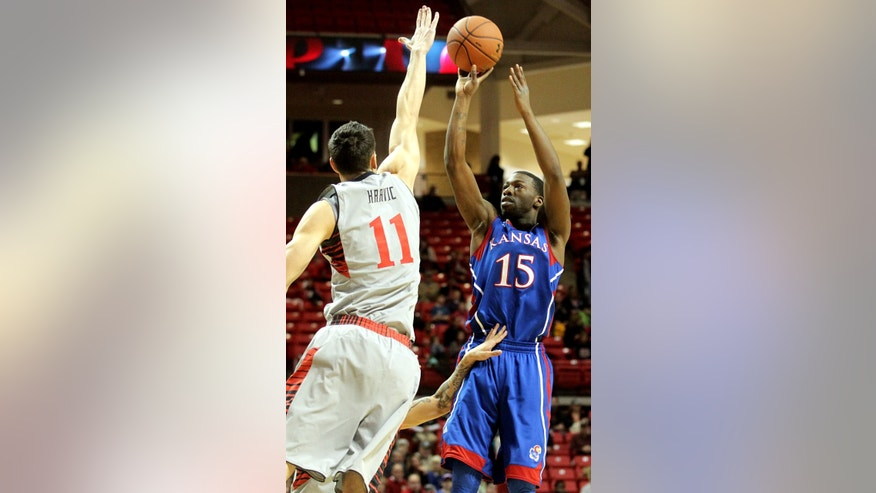Kansas' Elijah Johnson shoots over Texas Tech's Dejan Kravic during an NCAA college basketball game in Lubbock, Texas, Saturday, Jan. 12, 2013. (AP Photo/Lubbock Avalanche-Journal,Stephen Spillman)
