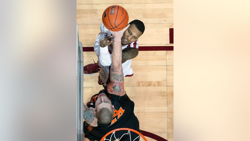 Oklahoma forward Romero Osby, top, shoots over Oklahoma State forward Philip Jurick, bottom, in the first half of an NCAA college basketball game in Norman, Okla., Saturday, Jan. 12, 2013. (AP Photo/Sue Ogrocki)