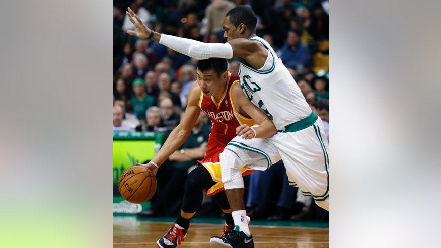 Houston Rockets' Jeremy Lin, left, drives past Boston Celtics' Rajon Rondo in the second quarter of an NBA basketball game in Boston, Friday, Jan. 11, 2013. (AP Photo/Michael Dwyer)