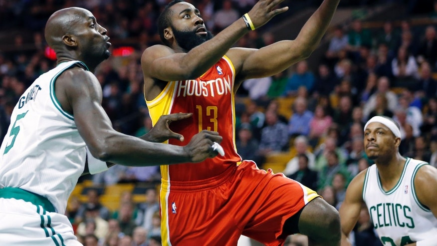 Houston Rockets' James Harden (13) goes up to shoot past Boston Celtics' Kevin Garnett (5) as Paul Pierce, right, watches during the first quarter of an NBA basketball game in Boston, Friday, Jan. 11, 2013. (AP Photo/Michael Dwyer)