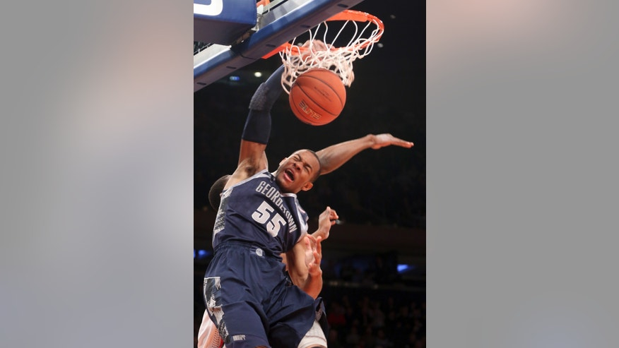 Georgetown's Jabril Trawick dunks during the first half NCAA college basketball game against St. John's, Saturday, Jan. 12, 2013, at Madison Square Garden in New York.  (AP Photo/Mary Altaffer)