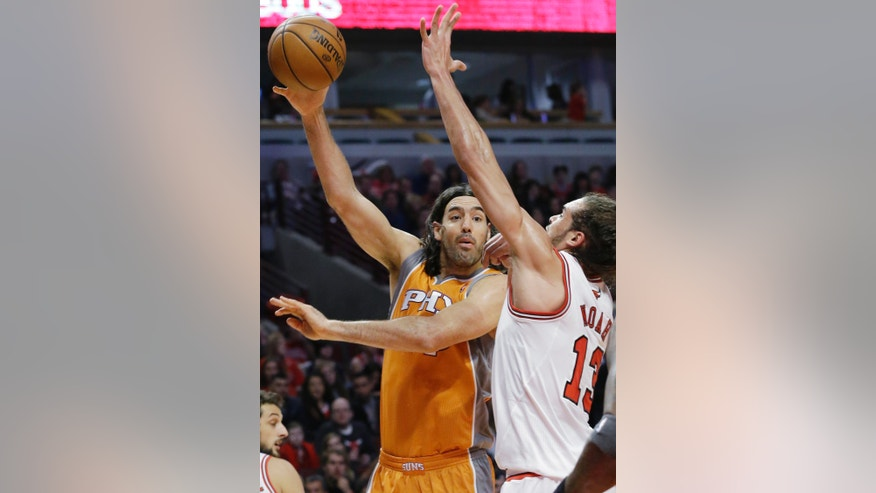 Phoenix Suns forward Luis Scola, left, passes the ball against Chicago Bulls center Joakim Noah during the first half of an NBA basketball game in Chicago on Saturday, Jan. 12, 2013. (AP Photo/Nam Y. Huh)