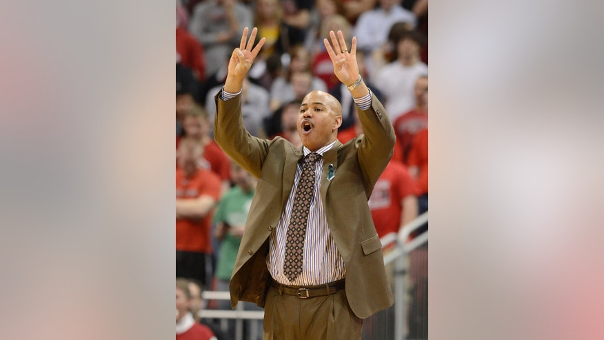 South Florida coach Stan Heath signals a play in to his team during the first half of an NCAA college basketball game against Louisville on Saturday Jan. 12, 2013, in Louisville, Ky. (AP Photo/Timothy D. Easley)
