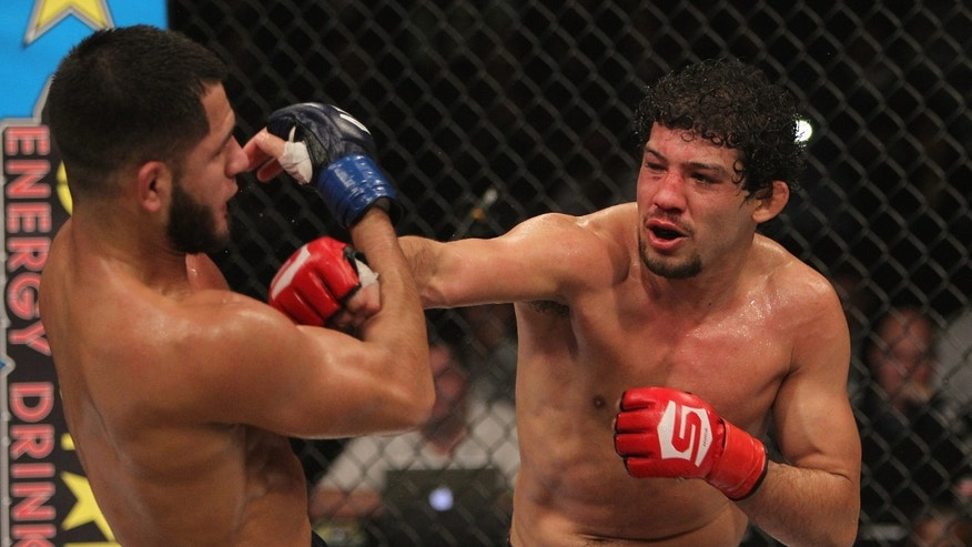 Gilbert Melendez punches Jorge Masvidal during the Strikeforce event at the Valley View Casino Center on December 17, 2011 in San Diego, California.
