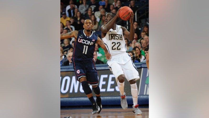 Notre Dame guard Jerian Grant, right, throws a pass around Connecticut guard Ryan Boatright during the first half of an NCAA college basketball game, Saturday, Jan. 12, 2013, in South Bend, Ind. (AP Photo/Joe Raymond)