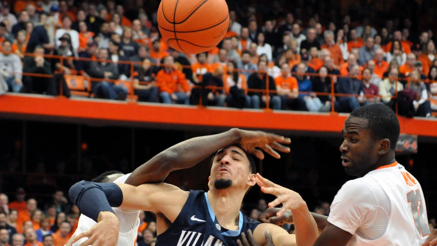 Villanova's Maurice Sutton battles Syracuse's Jerami Grant, left, and Baye Moussa Keita for a loose ball during the first half of an NCAA college basketball game in Syracuse, N.Y., Saturday, Jan. 12, 2013. (AP Photo/Kevin Rivoli)