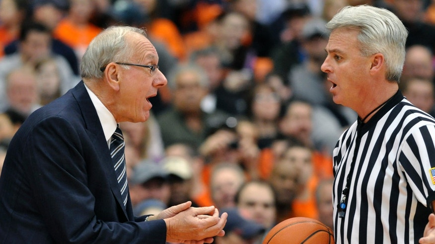 Syracuse head coach Jim Boeheim argues with referee Brian O'Connell during the first half against Villanova in an NCAA college basketball game in Syracuse, N.Y., Saturday, Jan. 12, 2013. (AP Photo/Kevin Rivoli)