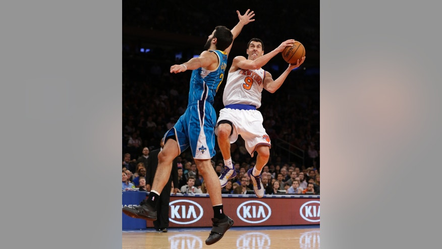 New York Knicks guard Pablo Prigioni goes for a layup as New Orleans Hornets guard Greivis Vasquez (21) defends in the first half of their NBA basketball game at Madison Square Garden in New York, Sunday, Jan. 13, 2013. (AP Photo/Kathy Willens)