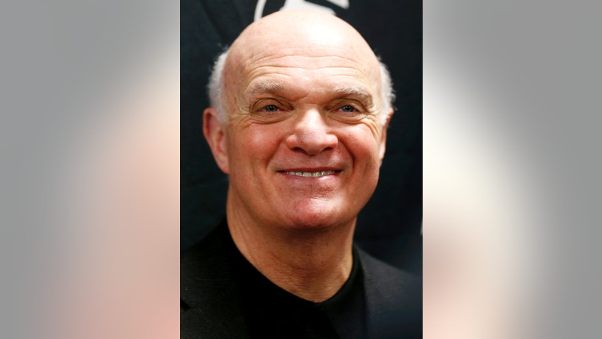 New Jersey Devils general manager Lou Lamoriello smiles while talking to reporters before the team's first official practice since the NHL hockey lockout ended, Sunday, Jan. 13, 2013, in Newark, N.J. (AP Photo/Julio Cortez)