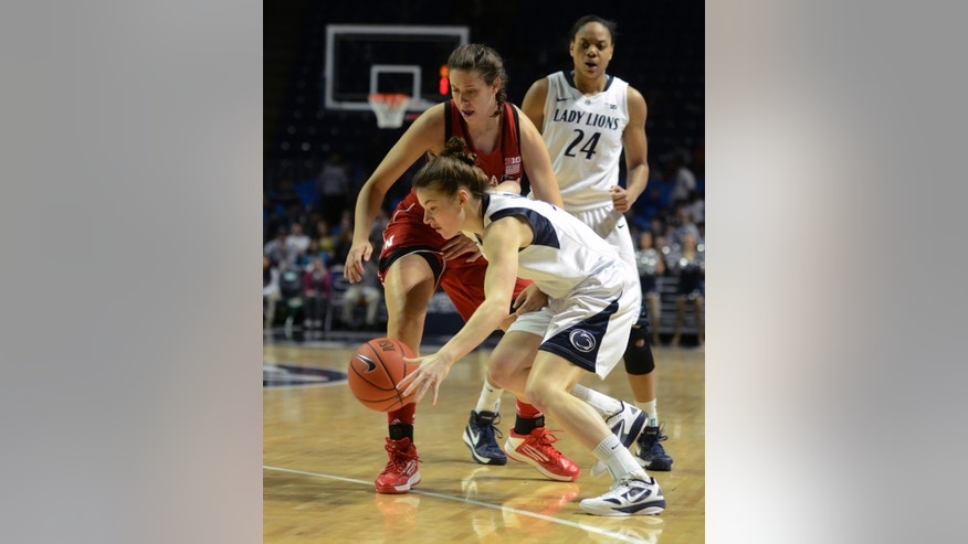 CORRECTS YEAR TO 2013 - Penn State's Maggie Lucas finds room around Nebraska's Hallie Sample during the first half of an NCAA college basketball game in State College, Pa., Sunday, Jan 13, 2013. (AP Photo/Ralph Wilson)