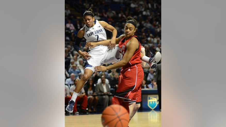 CORRECTS YEAR TO 2013 - Penn State's Dara Taylor (2) looses control of the ball as Nebraska's Meghin Williams (10) blocks her during the first half of an NCAA college basketball game in State College, Pa., Sunday, Jan 13, 2013. (AP Photo/Ralph Wilson)