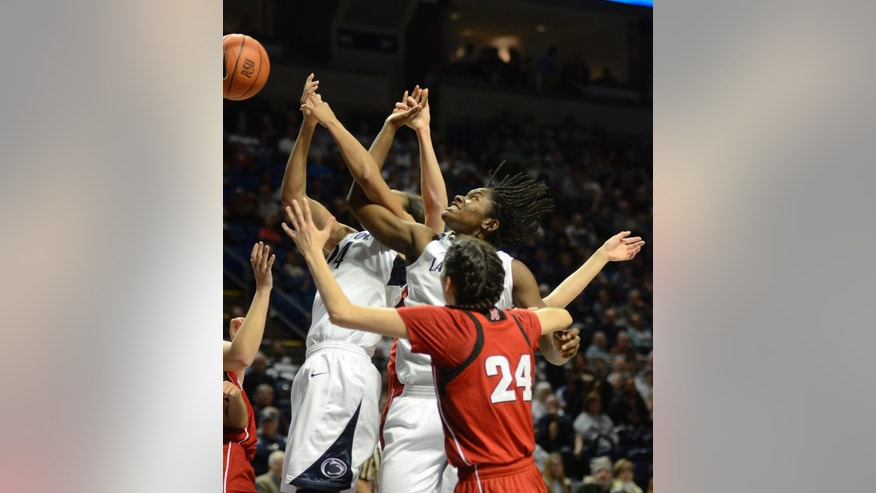CORRECTS YEAR TO 2013 - Penn State's Mia Nickson and Nikki Greene (54) get tangled up reaching for a rebound as Nebraska's Emily Cady (24) watches during the first half of an NCAA college basketball game in State College, Pa., Sunday, Jan 13, 2013. (AP Photo/Ralph Wilson)