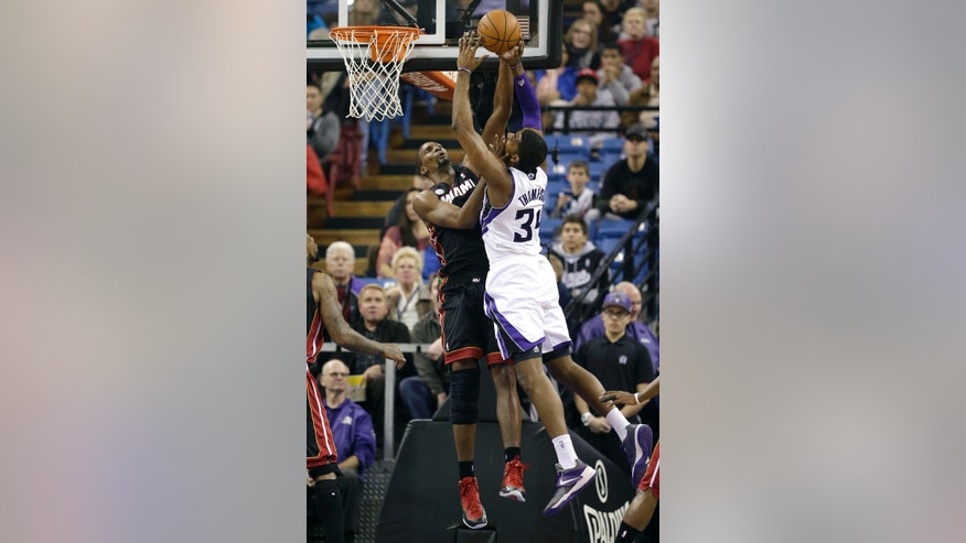 Miami Heat  forward Chris Bosh, left, blocks the shot of Sacramento Kings forward Jason Thompson during the first quarter of an NBA basketball game in Sacramento, Calif., Saturday, Jan. 12, 2013. (AP Photo/Rich Pedroncelli)
