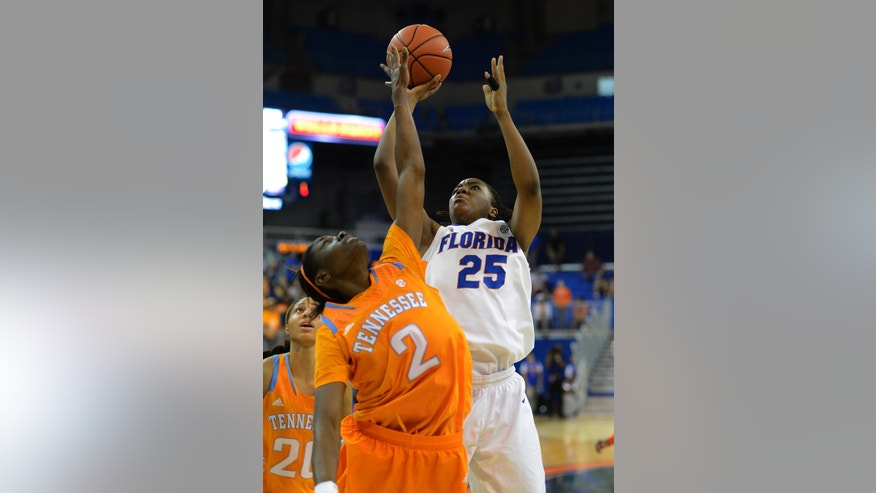 Florida forward Christin Mercer (25) tries to get the ball over Tennessee forward Jasmine Jones (2)  during the second half of an NCAA college basketball game in Gainesville, Fla., Sunday, Jan. 13, 2013. Jasmine Jones deflected the shot and Tennessee defeated Florida 78-75.  (AP Photo/Phil Sandlin)