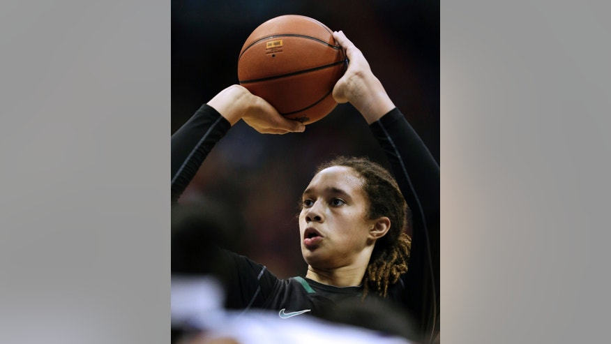 Baylor center Brittney Griner (42) shoots a free throw during the first half of an NCAA college basketball game against the Kansas in Lawrence, Kan., Sunday, Jan. 13, 2013. (AP Photo/Orlin Wagner)