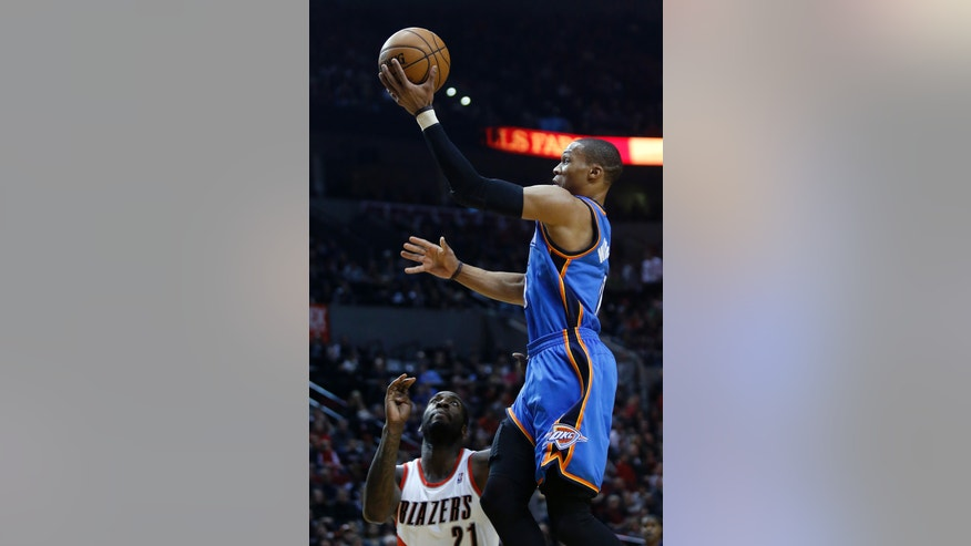 Oklahoma City Thunder guard Russell Westbrook, right, goes to the basket against Portland Trail Blazers center J.J. Hickson during the first quarter of an NBA basketball game in Portland, Ore., Sunday, Jan. 13, 2013. (AP Photo/Don Ryan)