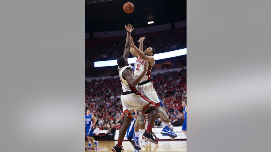 UNLV forwards Anthony Bennett (15) and  Khem Birch (2) compete for a rebound against an Air Force player, obscured, during the first half of an NCAA college basketball game, Saturday, Jan. 12, 2013, in Las Vegas. (AP Photo/Eric Jamison)