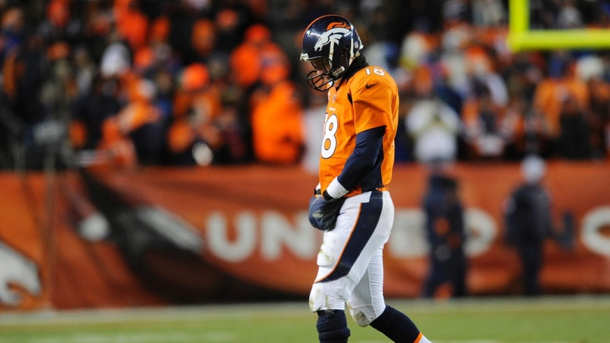Denver Broncos quarterback Peyton Manning  walks off the field against the Baltimore Ravens in the fourth quarter of an AFC divisional playoff NFL football game, Saturday, Jan. 12, 2013, in Denver. (AP Photo/Jack Dempsey)