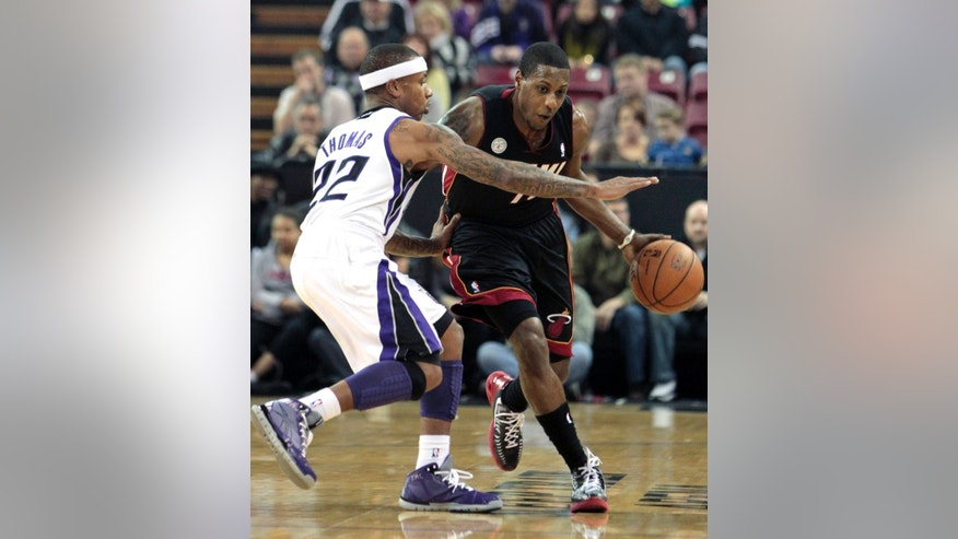 Miami Heat guard Mario Chalmers, right, drives against Sacramento Kings  guard Isaiah Thomas during the first quarter of an NBA basketball game in Sacramento, Calif., Saturday, Jan. 12, 2013.  Chalmers scored 34 points to lead the Heat in a 128-99 win over the Kings. (AP Photo/Rich Pedroncelli)