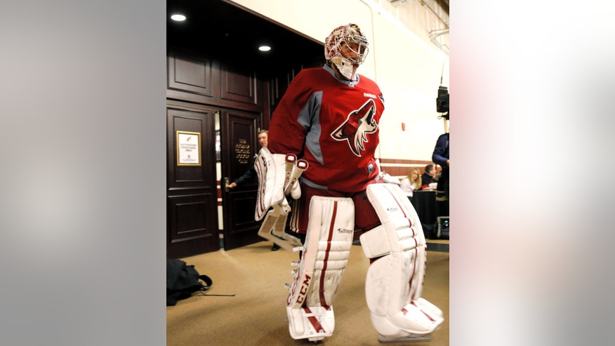 Phoenix Coyotes goalie Jason Labarera heads to the ice for the team's first voluntary skate, Sunday, Jan. 13, 2013, in Glendale, Ariz., since the NHL and the players' union reached a contract agreement on Saturday. (AP Photo/Matt York)
