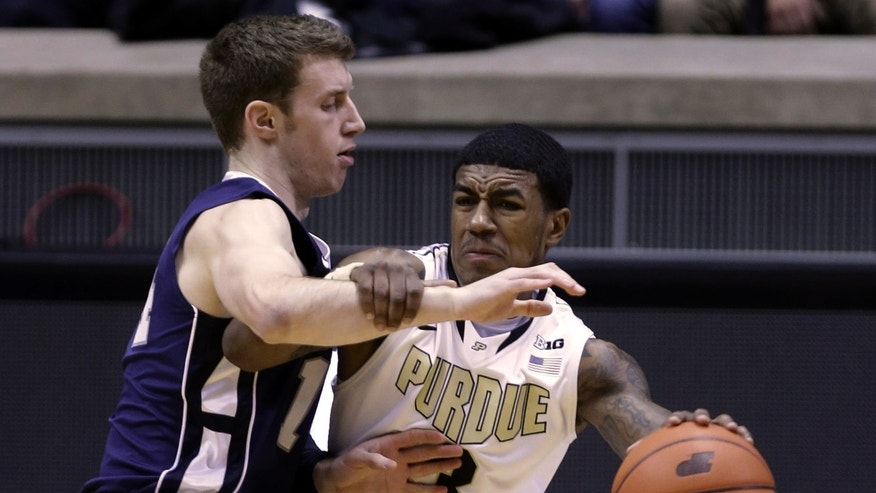 Purdue guard Ronnie Johnson, right, attempts to hold off Penn State guard Kevin Montminy in the first half of an NCAA college basketball game in West Lafayette, Ind., Sunday, Jan. 13, 2013.  (AP Photo/Michael Conroy)