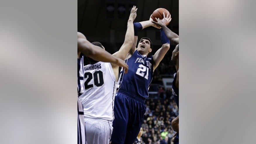 Penn State forward Sasa Borovnjak, right, shoots over Purdue center A.J. Hammons in the first half of an NCAA college basketball game in West Lafayette, Ind., Sunday, Jan. 13, 2013.  (AP Photo/Michael Conroy)