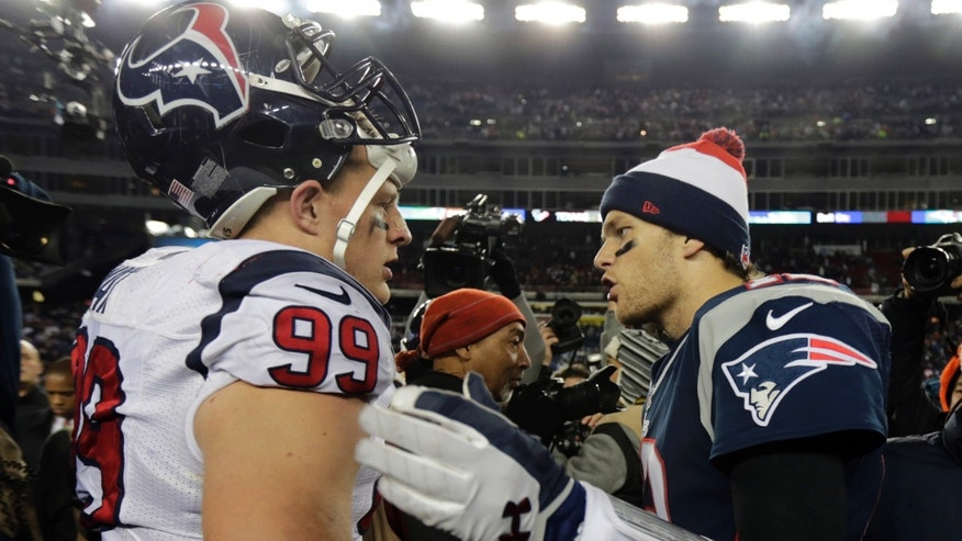 New England Patriots quarterback Tom Brady, right, talks with Houston Texans defensive end J.J. Watt following their AFC divisional playoff NFL football game in Foxborough, Mass., Sunday, Jan. 13, 2013. The Patriots defeated the Texans 41-28. (AP Photo/Charles Krupa)