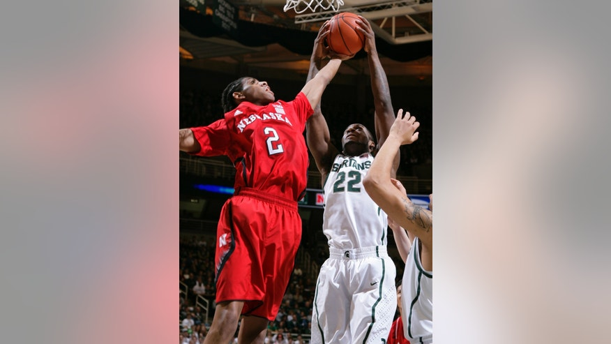 Nebraska's David Rivers (2) and Michigan State's Branden Dawson (22) reach for a rebound during the first half of an NCAA college basketball game, Sunday, Jan. 13, 2013, in East Lansing, Mich. (AP Photo/Al Goldis)