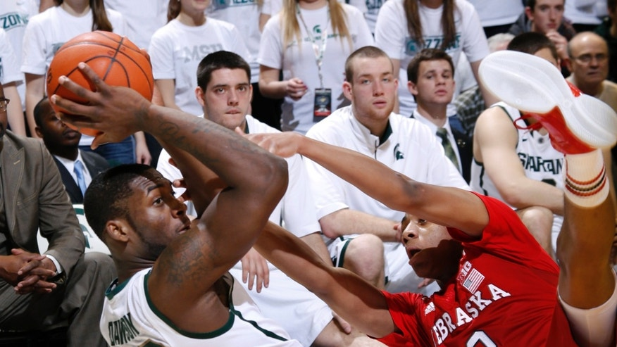 Michigan State's Branden Dawson (22) and Nebraska's David Rivers (2) vie for a loose ball during the first half of an NCAA college basketball game, Sunday, Jan. 13, 2013, in East Lansing, Mich. (AP Photo/Al Goldis)