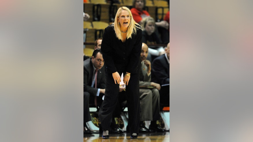 Maryland's head coach Brenda Frese instructs her players against Virginia Tech's during the first half of an NCAA college basketball game Sunday, Jan.13, 2013 at Cassell Coliseum, in Blacksburg, Va. (AP Photo/Don Petersen)