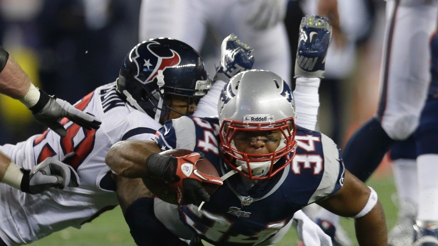 New England Patriots running back Shane Vereen (34) is tackled by Houston Texans strong safety Glover Quin during the first half of an AFC divisional playoff NFL football game in Foxborough, Mass., Sunday, Jan. 13, 2013. (AP Photo/Elise Amendola)