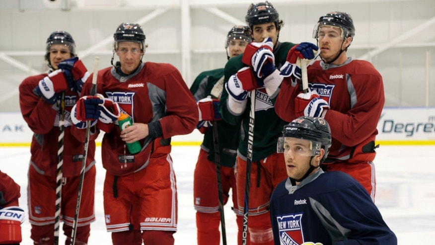 New York Rangers players, including Ryan Callahan, bottom right, listen during an informal NHL hockey workout, Wednesday, Jan. 9, 2013, in Greenburgh, NY.  (AP Photo/Seth Wenig)