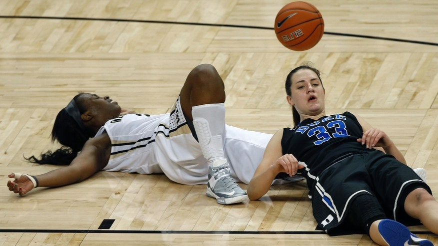 Wake Forest's Asia Williams, left, and Duke's Haley Peters, right, fall to the court after colliding during the second half of an NCAA college basketball game in Winston-Salem, N.C., Sunday, Jan. 13, 2013. Duke won 73-44. (AP Photo/Chuck Burton)