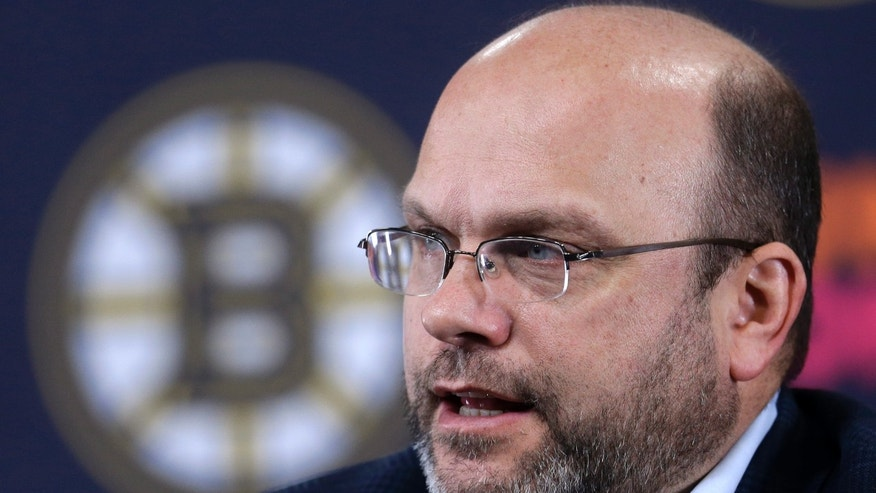 Boston Bruins general manager Peter Chiarelli responds to a question from a reporter during a news conference at the TD Garden before a scheduled NHL team hockey practice in Boston, Sunday, Jan. 13, 2013. (AP Photo/Steven Senne)