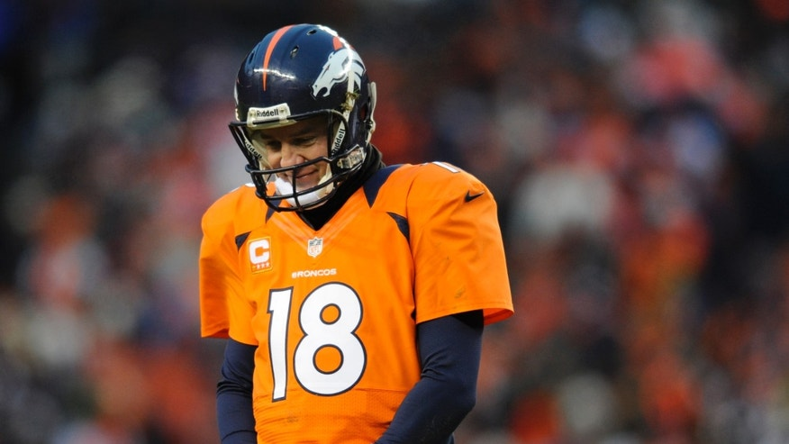 Denver Broncos quarterback Peyton Manning walks off the field after fumbling the ball against the Baltimore Ravens in the third quarter of an AFC divisional playoff NFL football game, Saturday, Jan. 12, 2013, in Denver. (AP Photo/Jack Dempsey)
