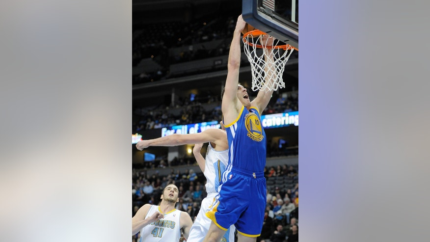 Golden State Warriors forward David Lee, right, dunks over Denver Nuggets forward Danilo Gallinari, left, in the first quarter of an NBA basketball game on Sunday, Jan. 13, 2013, in Denver. Denver center Kosta Koufos is at bottom left. (AP Photo/Chris Schneider)