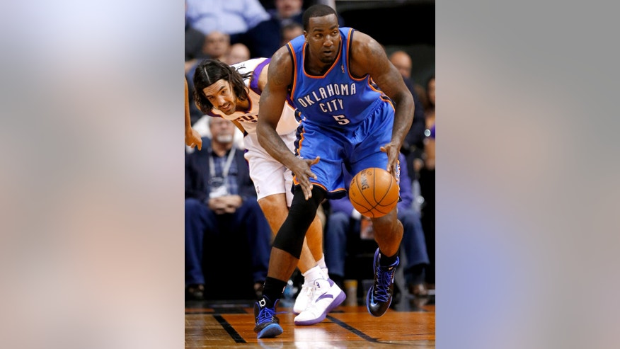 Oklahoma City Thunder center Kendrick chases down the loose ball as Phoenix Suns forward Luis Scola, of Argentina, pursues during the first half of an NBA basketball game, Monday, Jan. 14, 2013, in Phoenix. (AP Photo/Matt York)