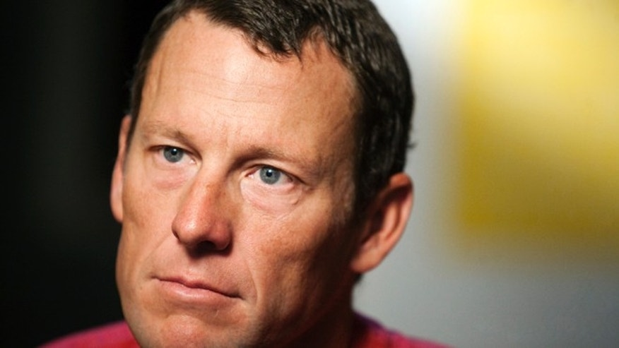 Feb. 15, 2011: In this file photo, Lance Armstrong pauses during an interview in Austin, Texas.