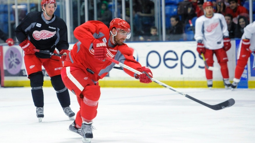 Detroit Red Wings' Henrik Zetterberg takes a shot during the NHL hockey team's practice Sunday, Jan. 13, 2013, in Plymouth, Mich. (AP Photo/The Detroit News, David Guralnick) DETROIT FREE PRESS OUT  HUFFINGTON POST OUT  MAGS OUT