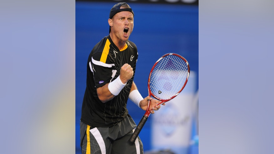 Australia's Lleyton Hewitt reacts during his first round match against Serbia's Janko Tipsarevic at the Australian Open tennis championship in Melbourne, Australia, Monday, Jan. 14, 2013. (AP Photo/Andrew Brownbill)
