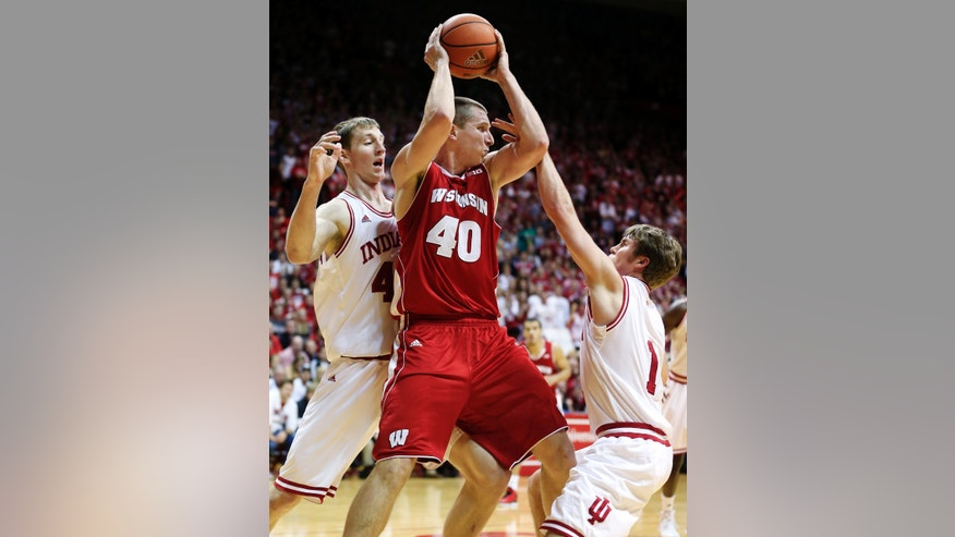 Wisconsin center Jared Berggren (40) is defended by Indiana forward Cody Zeller, left, and guard Jordan Hulls during the first half of an NCAA college basketball game, Tuesday, Jan. 15, 2013, in Bloomington, Ind. (AP Photo/Darron Cummings)