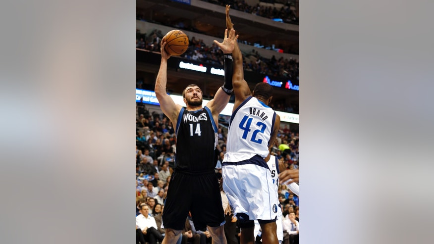 Minnesota Timberwolves center Nikola Pekovic (14), of Montenegro, shoots over Dallas Mavericks forward Elton Brand (42) during the first half of an NBA basketball game, Monday, Jan. 14, 2013, in Dallas. (AP Photo/Sharon Ellman)