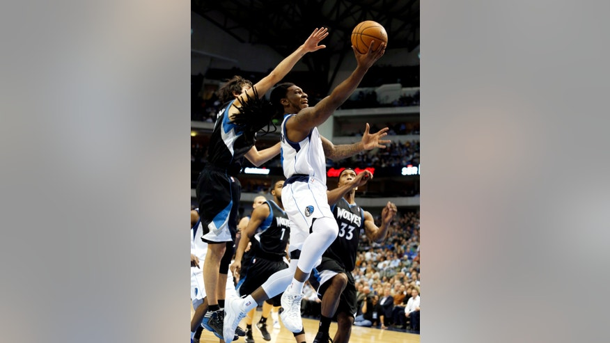 Dallas Mavericks forward Jae Crowder (9) shoots as Minnesota Timberwolves guard Ricky Rubio, left, of Spain, and forward Dante Cunningham (33) defend during the first half of an NBA basketball game, Monday, Jan. 14, 2013, in Dallas. (AP Photo/Sharon Ellman)