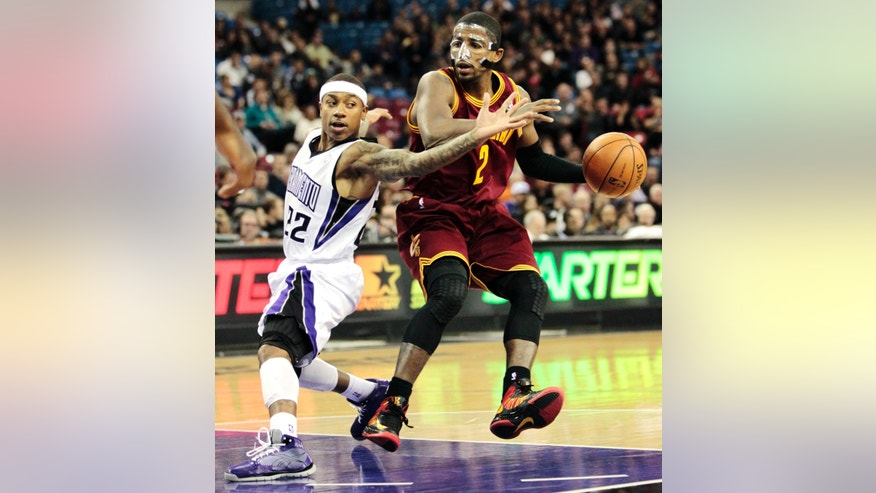 Sacramento Kings guard Isaiah Thomas, left, defends against Cleveland Cavaliers guard Kyrie Irving during the first quarter of an NBA basketball game in Sacramento, Calif., Monday, Jan. 14, 2013. (AP Photo/Rich Pedroncelli)