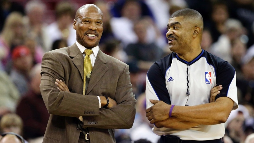 Cleveland Cavaliers head coach Byron Scott, left, talks with official Tony Brothers during a break in an NBA basketball game against the   Sacramento Kings in Sacramento, Calif., Monday, Jan. 14, 2013. (AP Photo/Rich Pedroncelli)